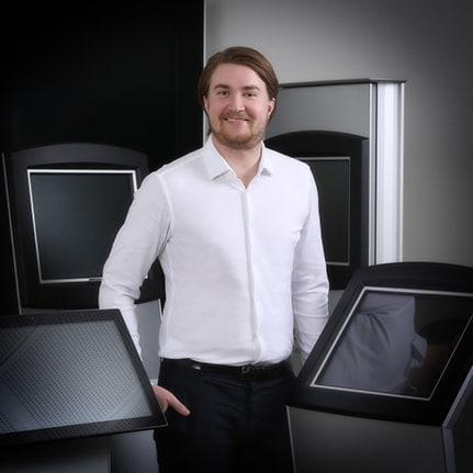 Thomas Sorensen standing in front of kiosks