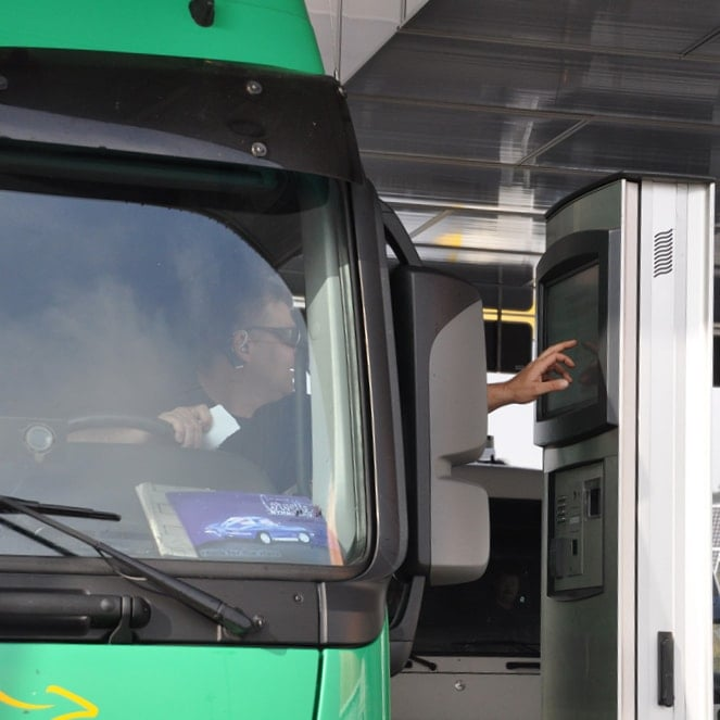 Touch screen kiosk FLEXI Access Gate being used by truck driver